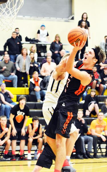 SPOTLIGHT PHOTO: JAKE MCNEAL - Ian Donaldson's and-one put Scappoose ahead 62-59 with 33.7 seconds left on Tuesday in Philomath.
