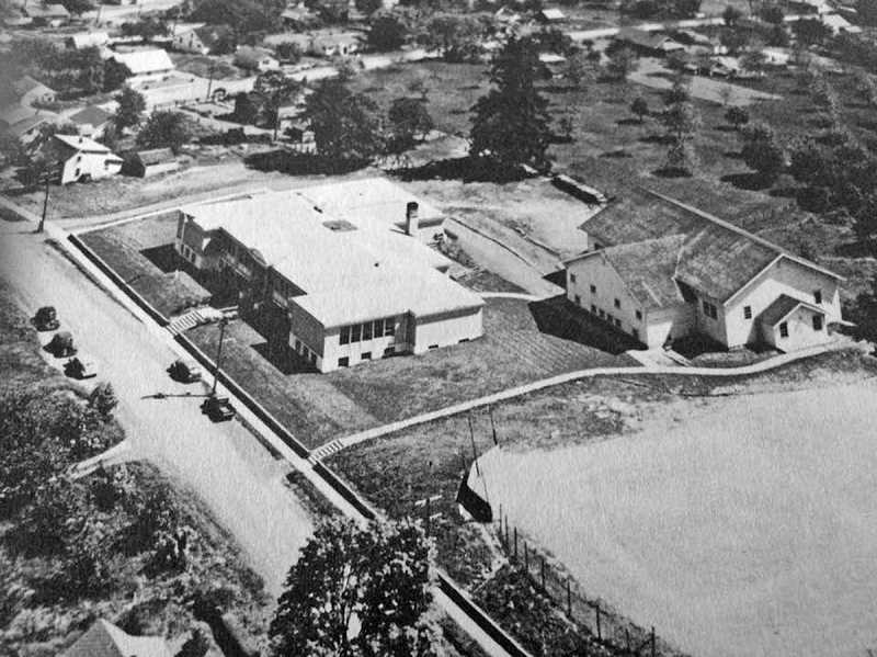 COURTESY PHOTO - In 1915, Gaston residents voted to build a public high school (pictured here at left, with the large old gym to the right) even though many state leaders thought free education should stop at eighth grade.