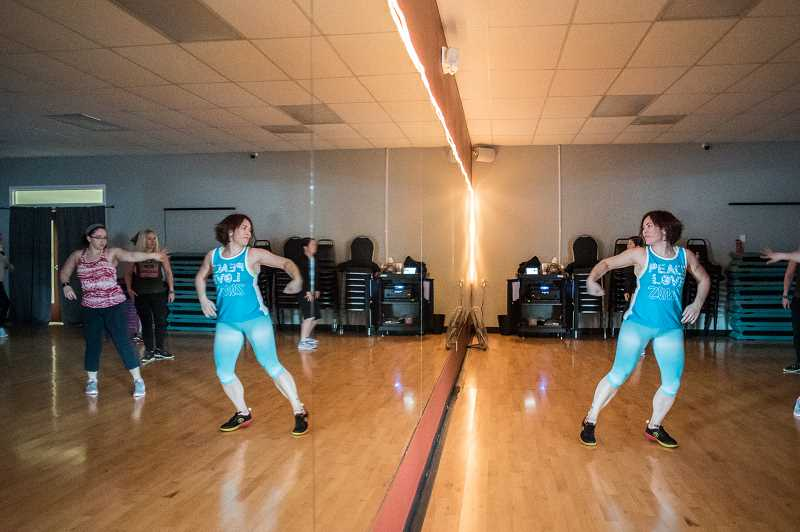 NEWS-TIMES PHOTO: CHASE ALLGOOD - Stephanie Broding-Sherwood leads a Zumba class at Fitness 1440 Gym in Forest Grove.