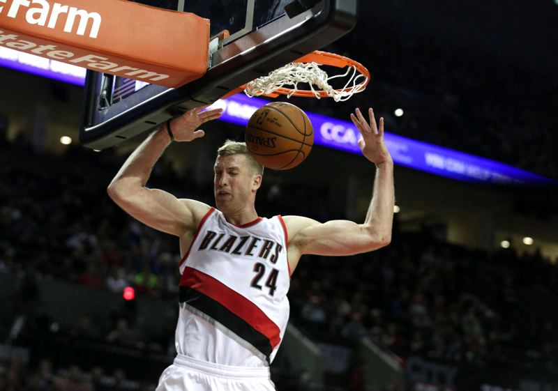 TRIBUNE PHOTO: JONATHAN HOUSE - Trail Blazers center Mason Plumlee gets a dunk against Utah.