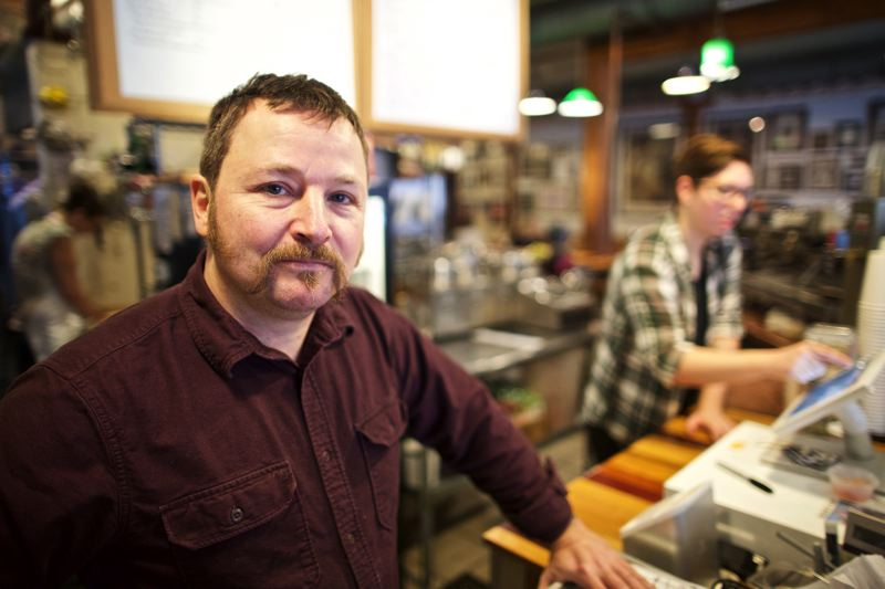 TRIBUNE PHOTO: JAIME VALDEZ - BIpartisan Cafe owner Peter Emerson wants to pay his workers $15 an hour, but he says thats only possible if the higher minimum wage becomes law and his competitors have to do the same.