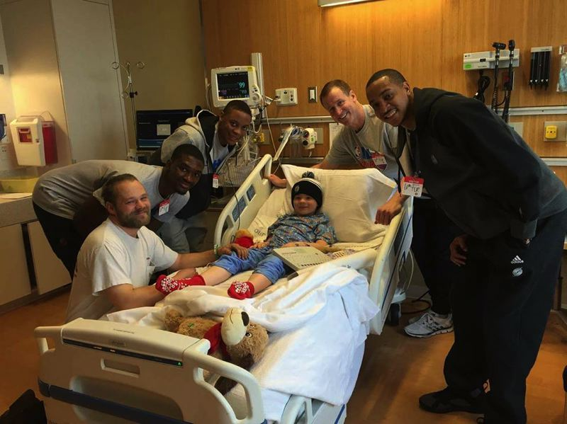 COURTESY OF THE MANN FAMILY - Nate Mann, a 7-year-old of Deer Island, (center), poses for a photo with his father, Rodney Mann, and Portland Trail Blazers basketball team members Noah Vonleh, Al-Farouq Aminu, Terry Stotts and Tim Frazier, at the Randall Children's Hospital at Legacy Emanuel in Portland on Thursday, Jan. 7.