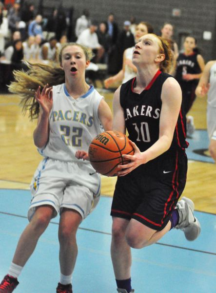 MATTHEW SHERMAN - Lake Oswego's Gillian Mair looks to convert a lay-up during her team's 19-point victory over Lakeridge on Tuesday.