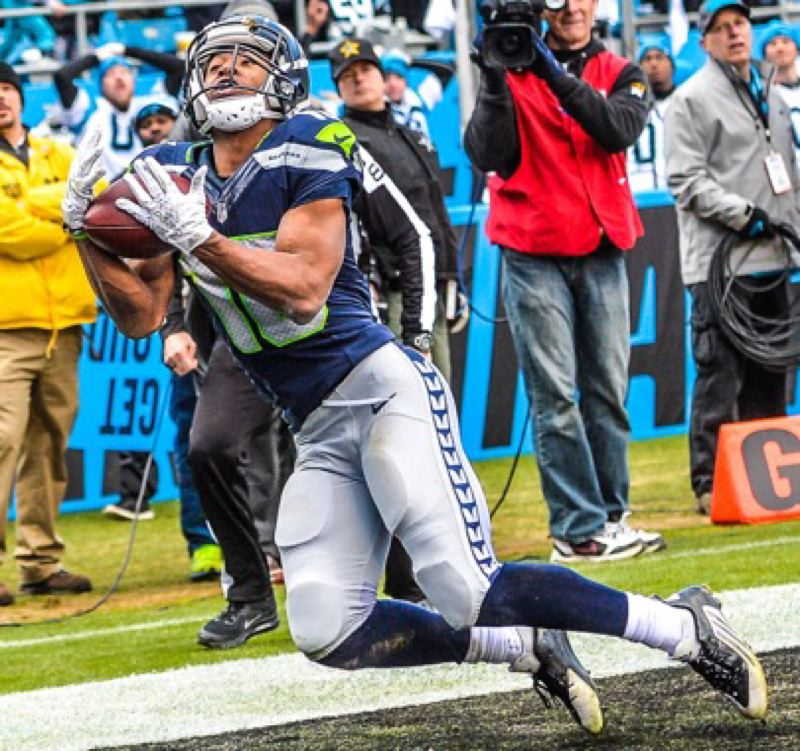 Tyler Lockett hauls in a 33-yard touchdown pass from Russell Wilson in the third quarter on Sunday, as the Seattle Seahawks mount a rally against Carolina before falling 31-24 to the Panthers in the NFL playoffs.