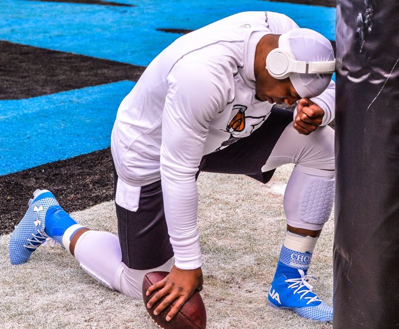 Carolina quarterback Cam Newton takes a private moment before the game.