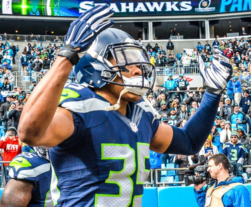 DeShawn Shead, starting defensive back for Seattle and a former Portland State Viking, tries to pump up the Hawks and their fan contingent.