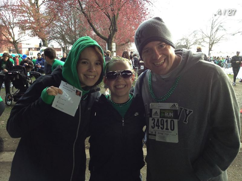 SUBMITTED PHOTO - Holding up their Kyla Cards at last year's Shamrock Run, are Kyla's mother, Brettie McCullough, sister, Kora McCullough, and father, Bret McCullough.