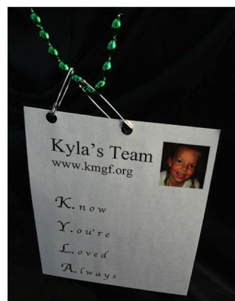 SUBMITTED PHOTO - Participants in the Shamrock Run wear 'Kyla Cards,' emblazoned with words spelling out her name: Know Youre Loved Always.