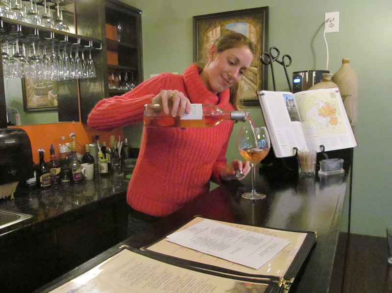PHOTOS BY DICK TRTEK - Gisella Barbaray, co-owner of Mezza, pours a glass of wine; she and her husband, Joris, Milwaukie residents, opened Mezza in October of 2015.