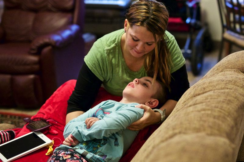 TRIBUNE PHOTO: JAIME VALDEZ - Mom Cyndy repositions Blue on the family couch.