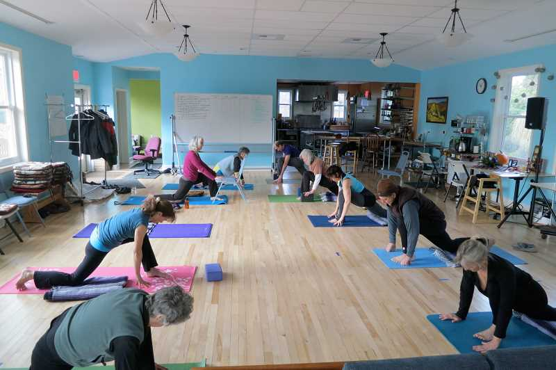 SUBMITTED PHOTO - Residents at Columbia Ecovillage in Northeast Portland use one of the community's common spaces for yoga. The community was built by two former Frog Pond residents who weren't able to build it there two decades ago.