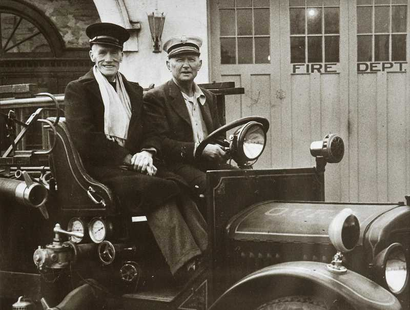 SUBMITTED PHOTO - Firefighters Arthur Red McVey and Joe Nemec sit in a fire engine for a photo taken around 1946.