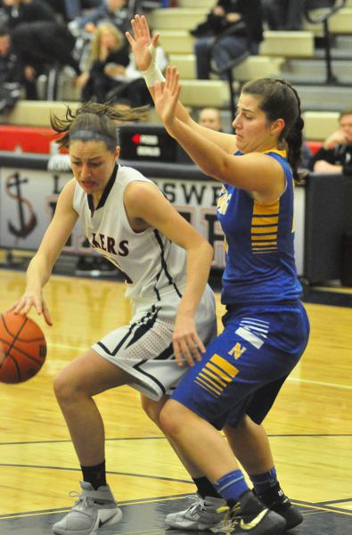 MATTHEW SHERMAN - Lake Oswego's Ellie Moreland starts a drive against a Newberg defender in Tuesday's loss to the Tigers.