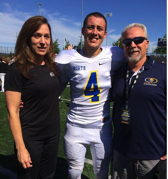 COURTESY: SCHLATTER FAMILY - Mom Terri Jo (left) and dad Jim share the excitement as AJ represents Canby as a member of the North all-star team in the annual Les Schwab Bowl.