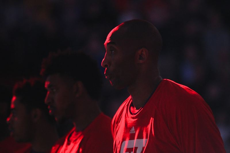 TRIBUNE PHOTO: JAIME VALDEZ - Kobe Bryant stands for the national anthem Saturday night before his final NBA game in Portland.