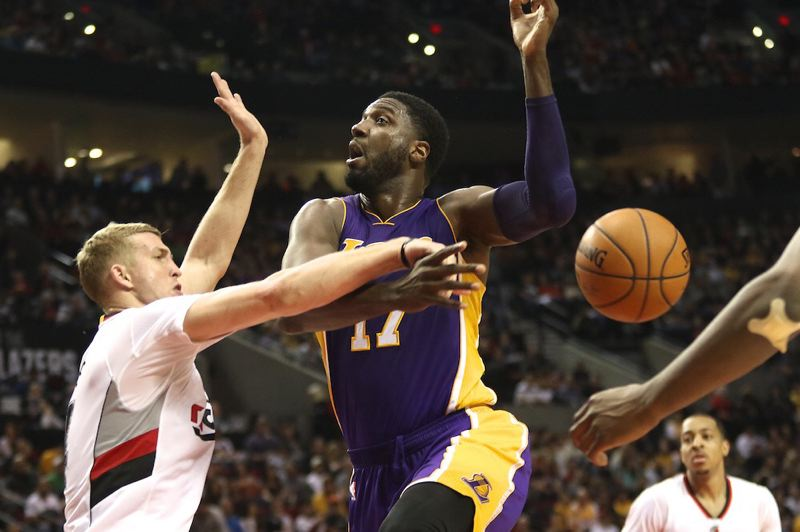 TRIBUNE PHOTO: JAIME VALDEZ - Trail Blazers center Mason Plumlee knocks the ball out of Los Angeles Lakers center Roy Hibbert's hands as he goes up for a shot.