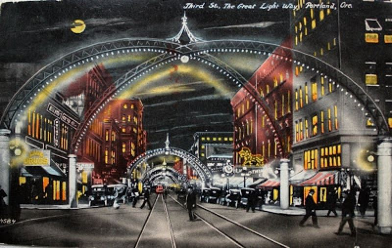 COURTESY: OREGON HISTORICAL SOCIETY - This old postcard shows some of the Third Street lighted arches that made the Great Light Way, part of the inspiration for the new Portland Winter Light Festival.