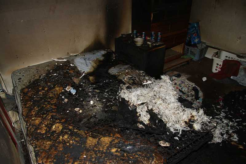 COURTESY PHOTO - Fire damage was contained to one room in a house on Southeast Tanager Circle in Hillsboro Monday night. A woman dropped her cigarette onto medical oxygen tubing, which ignited her mattress.