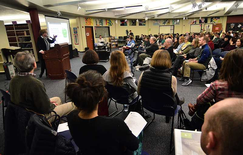 REVIEW PHOTO: VERN UYETAKE - At least 120 people attended a Jan. 20 public input session on the school district's Long Range Facilities Plan.