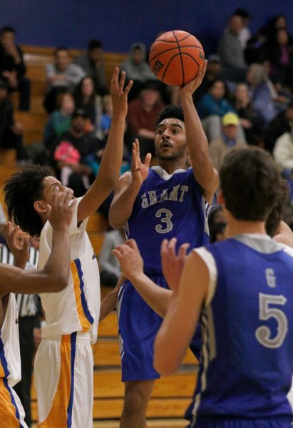 TRIBUNE PHOTO: JONATHAN HOUSE - Grant High's James Bullock pulls up for a shot at Jefferson on Tuesday night.
