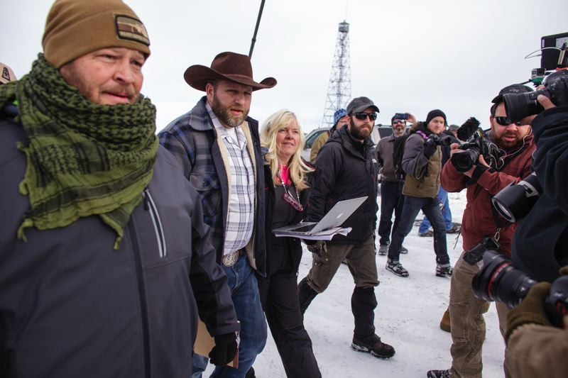 TRIBUNE PHOTO: ROB KERR - During the early days of the wildlife refuge occupation, Brian Cavalier, left, Ammon Bundy, Shawna Cox and Ryan Payne talked with news reporters about their cause. Cavalier, Bundy, Cox and Payne were in federal court Wednesday to face charges related to the case.