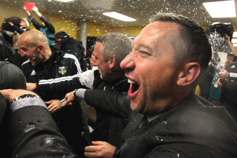 TRIBUNE FILE PHOTO: JAIME VALDEZ - Portland Timbers coach Caleb Porter, celebrating after the 2015 MLS Cup final victory over Columbus, is counting on some new players to keep his club in championship contention.