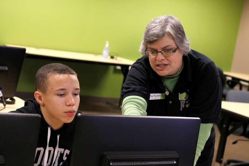 TIMES PHOTO: JONATHAN HOUSE - Pam Simon works with students during a learning module at Fidgets2Widgets.
