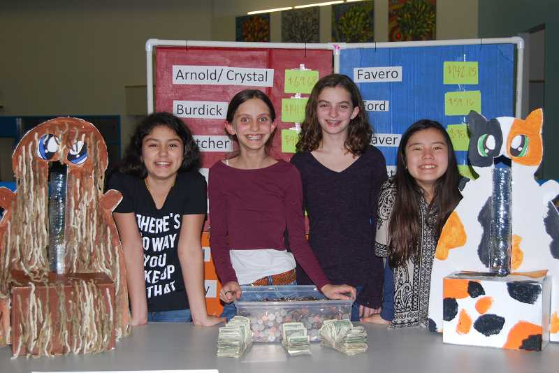 SUBMITTED PHOTO - Hallinan Elementary School fifth-graders (from left) Charlotte Pence, Allison Jaffe, Danielle Jaffe and Chloe Kim beam with their collection after a coin drive.