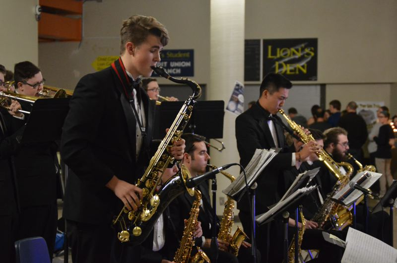 SPOTLIGHT PHOTO: NICOLE THILL - St. Helens High School Jazz Band members Alec Martinson and Donovan Jacob perform during the Beats and Eats benefit dinner and concert on Saturday, Jan 23. Members of the band stayed after their performance to enjoy dinner and a performance by Portland band Soul Brassanova.