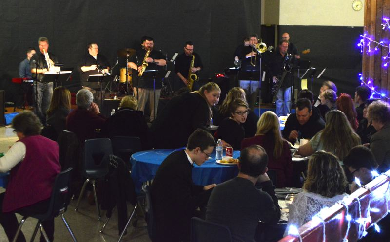 SPOTLIGHT PHOTO: NICOLE THILL - The Portland-based jazz band, Soul Brasssanova, performed a one-hour set during Saturday night's fundraiser at St. Helens High School. Travis Freshner,  a St. Helens School District substitute teacher, is one of the band's two trumpet players.