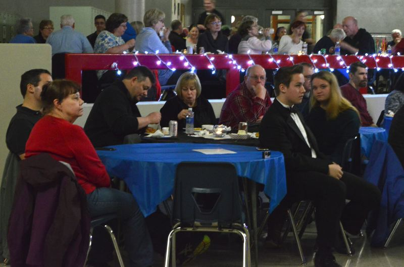SPOTLIGHT PHOTO: NICOLE THILL - Audience members enjoyed a meal of pulled pork, macaroni and cheese, coleslaw, baked beans and dessert during the dinner. The relaxed environment allowed audience members take in the performances while also enjoying a meal.