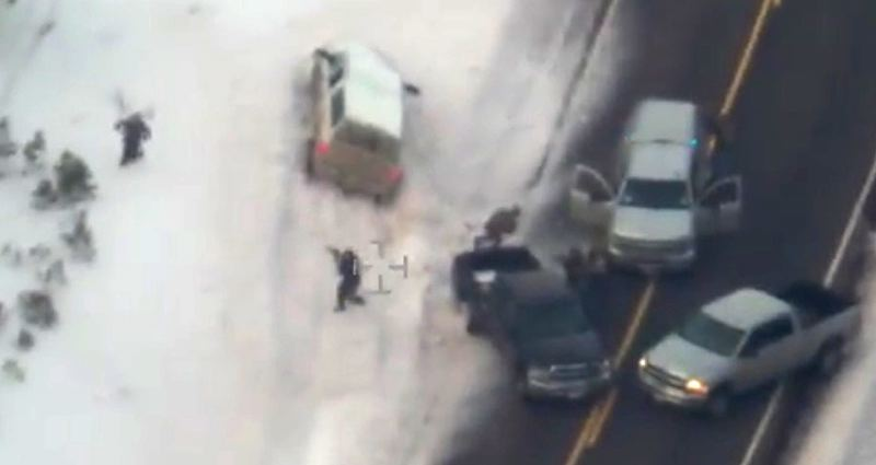 COURTESY OF THE FBI - A screenshot from the FBI overhead video of the Jan. 26 arrests on Highway 395 of militants who occupied the Malheur National Wildlife Refuge for four weeks, shows Oregon State Police troopers in a confrontation with Robert LaVoy Finicum after he climbed out of his white truck during a traffic stop.