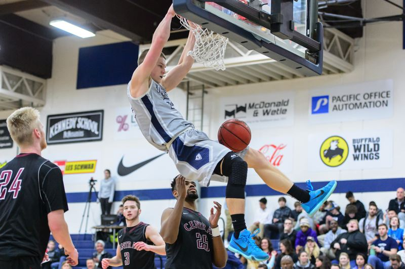 COURTESY: CHRISTOPHER OERTELL - James Phillips of Concordia dunks during Thursday's home game against Central Washington.
