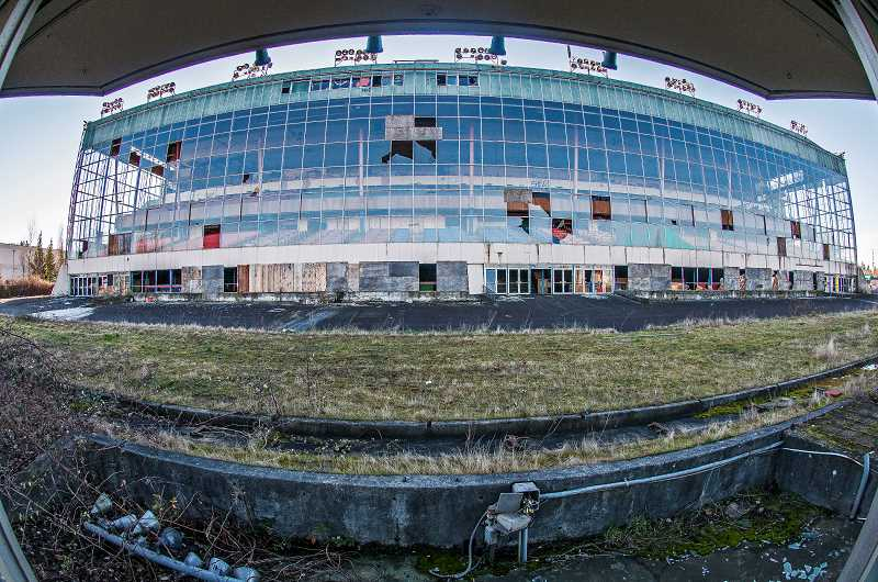 OUTLOOK PHOTO: JOSH KULLA - Abandoned since 2004, the Multnomah Greyhound Park's massive grandstand and infield carries signs of age and vandalism. Its new owners, the Grand Ronde Tribe, plans to tear down the structure this spring.