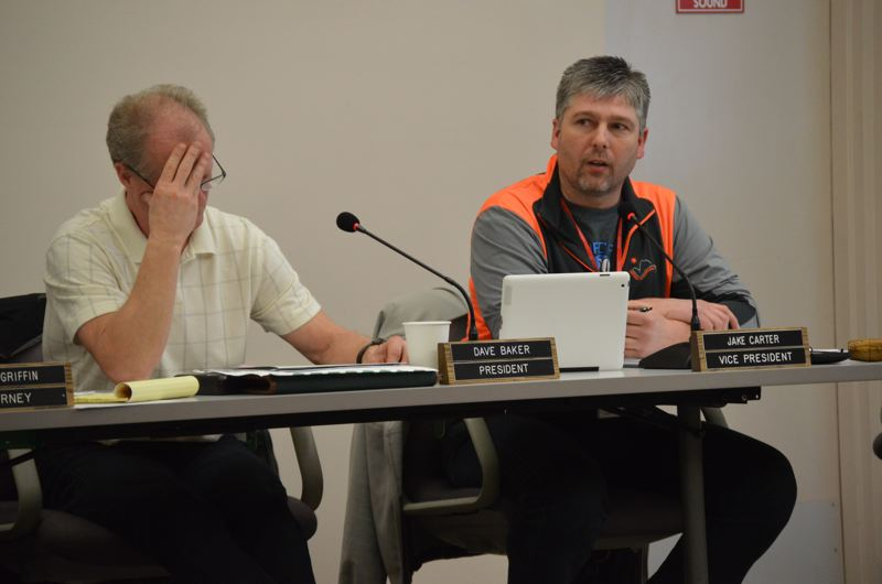 COURTNEY VAUGHN - Columbia River PUD Director Dave Baker (left) and President Jake Carter address ongoing division within the board during a public meeting Jan. 21. Recent unrest over a recall election and ongoing legal issues infused discussions during the meeting.