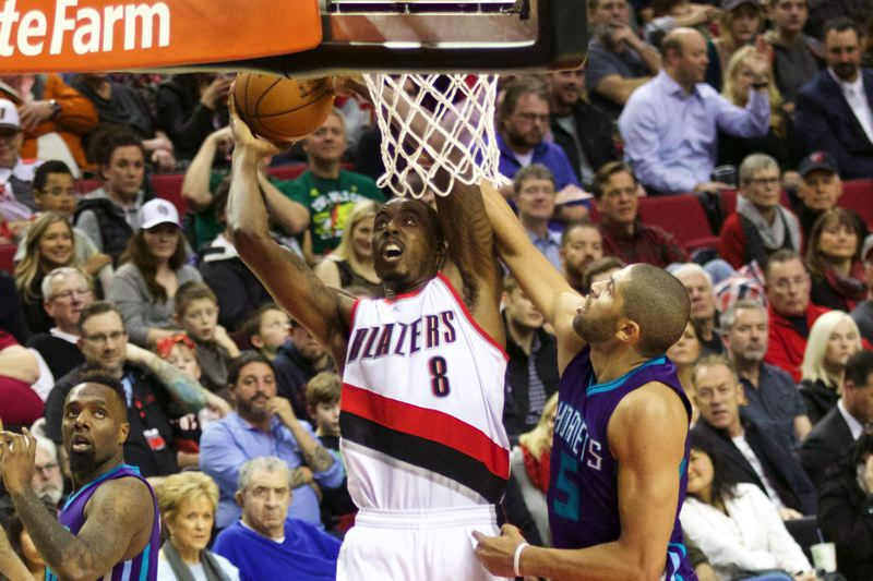 TRIBUNE PHOTO: JAIME VALDEZ - Nicolas Batum (right) of Charlotte fouls Portland forward Al-Farouq Aminu.