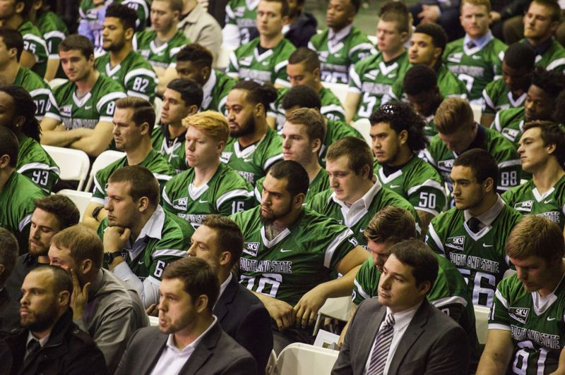 TRIBUNE PHOTO: ADAM WICKHAM - Portland State football players hear tributes to teammate AJ Schlatter during a Sunday memorial service at PSU for the Vikings linebacker who died Jan. 17.