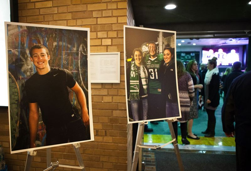 TRIBUNE PHOTO: ADAM WICKHAM - The entrance to the Stott Center gym on Sunday has numerous photos in remembrance of Portland State linebacker AJ Schlatter from Canby High.