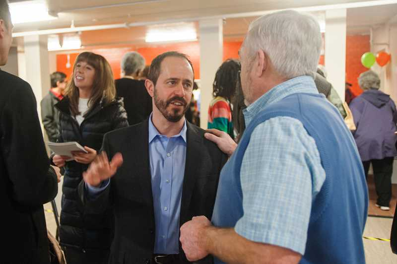 OUTLOOK PHOTO: JOSH KULLA - Human Solutions Executive Director Andy Miller talks with Gresham City Councilor Kirk French Monday at the grand opening of organizations new family homeless shelter on East Burnside Street in Portland.