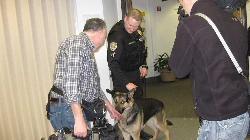 TIMES PHOTO: ERIC APALATEGUI - K-9 Officer Atlas sniffs a television camera operator before taking part in a ceremony to accept a grant for the Beaverton Police Department's K-9 program.