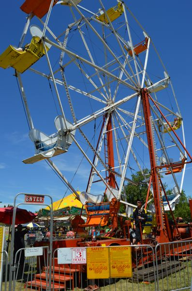 SPOTLIGHT FILE PHOTO - A Ferris wheel ride was part of the 2015 Scappoose Summerfest carnival. Last year's event organizers say there is no festival being planned for this year, due to a lack of community attendance and involvement.