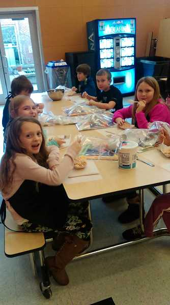 CONTRIBUTED PHOTO - Students at Clackamas River Elementary School enjoy the 'Food Hero' program's monthly visits to the school cafeteria.