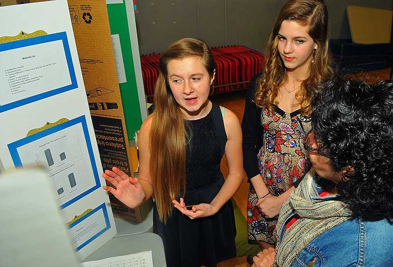 SPOKESMAN PHOTO: VERN UYETAKE - Wood seventh-graders Sophie Wheeler, left, and Kate Frechette discuss how sweets as rewards can improve test scores.