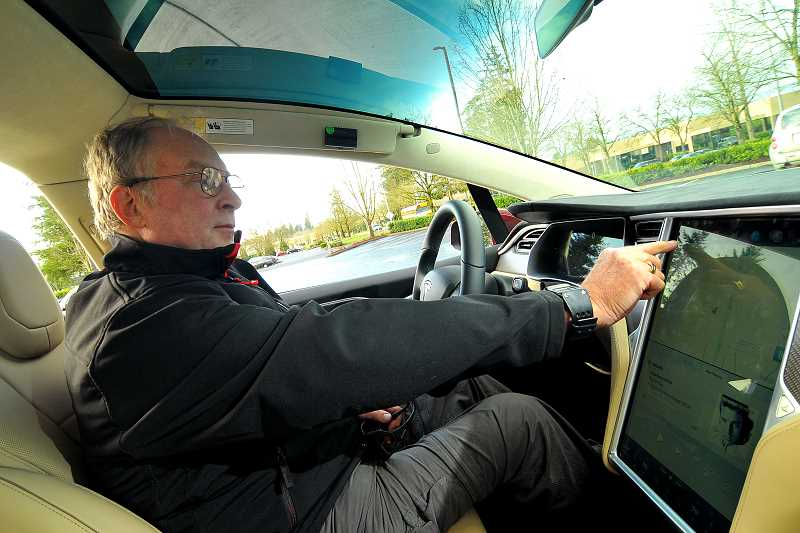 SPOKESMAN PHOTO: VERN UYETAKE - John Schenk's Tesla Model X features a 17-inch touch screen from which much of the car is controlled.