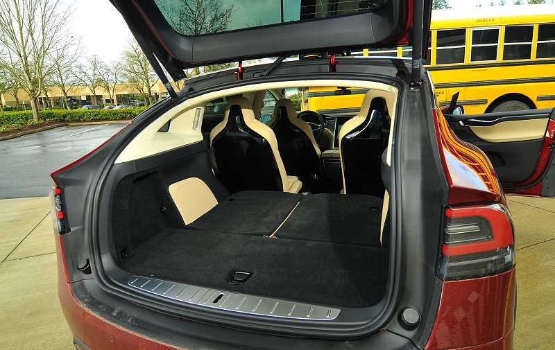 SPOKESMAN PHOTO: VERN UYETAKE - The Tesla Model X features both front and a rear trunks.