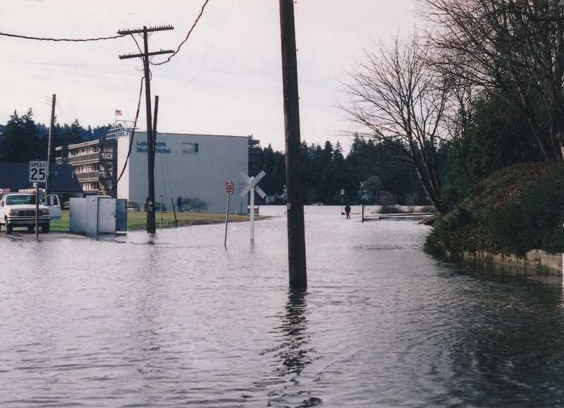 PHOTOS COURTESY LAKE OSWEGO PUBLIC LIBRARY - Water from Oswego Lake and Lakewood Bay covers the railroad tracks at State Street.