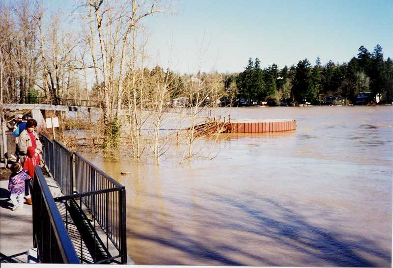 PHOTOS COURTESY LAKE OSWEGO PUBLIC LIBRARY - Lake Oswegans could only marvel at the height of the Willamette River, which swamped walkways near The Foundry at Oswego Pointe.