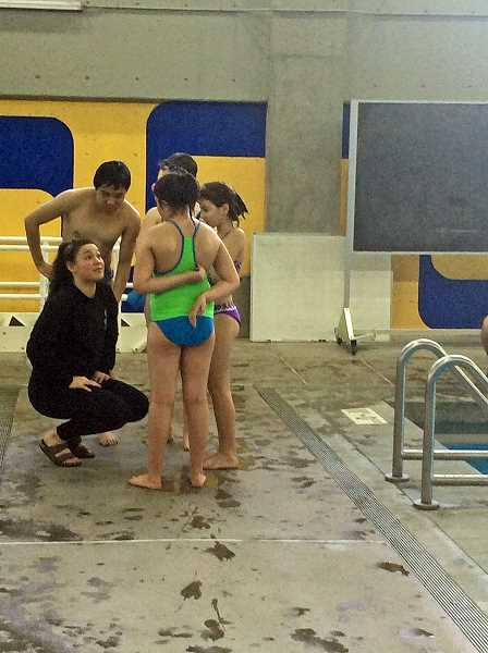 SUBMITTED PHOTO: MAISIE SHINDO - Katie Manzione, a Lakeridge swimmer, organized the free clinic for young swimmers this past weekend.