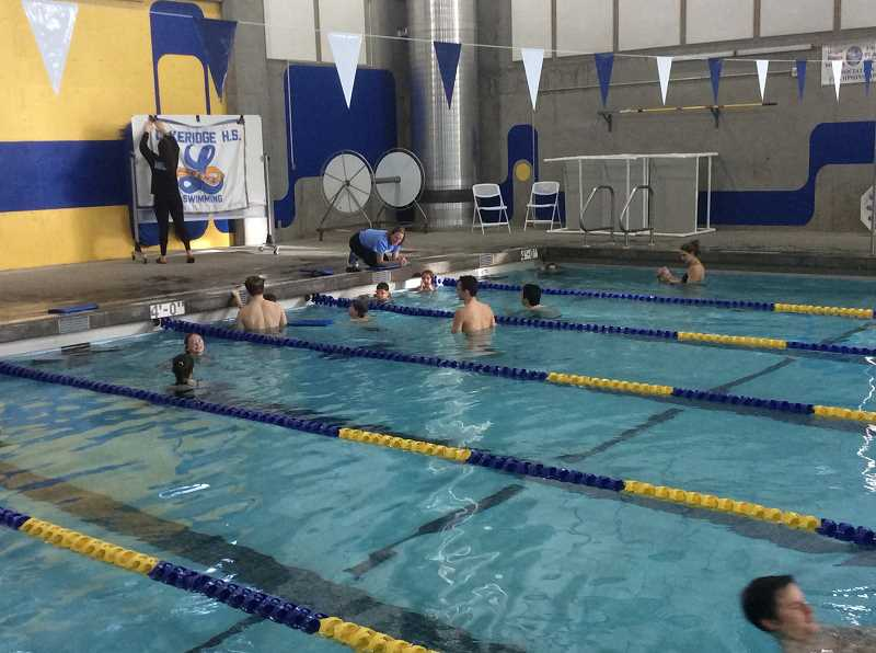 SUBMITTED PHOTO: MAISIE SHINDO - Lakeridge coach Brigitte Stacey Dennett offers instructions to some young swimmers.