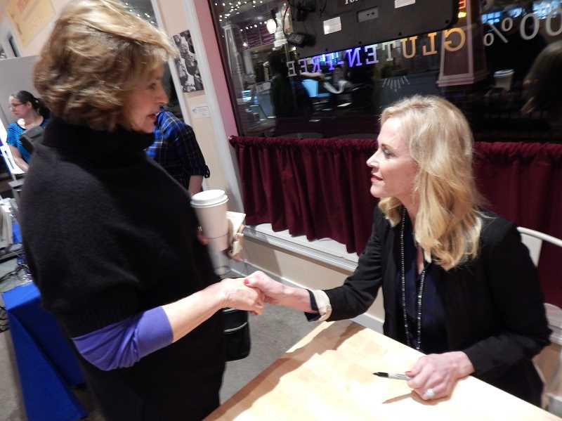 REVIEW, TIDINGS PHOTO: CLIFF NEWELL - Sheila Hamilton greets Kim Wrolstad at the authors event in Lake Oswego last week. Hamiltons new book is giving hope to caregivers of people with bipolar disorders.